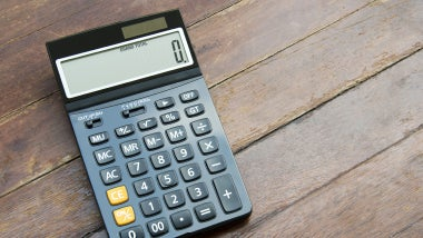black calculator on wooden surface behind job offer advice text