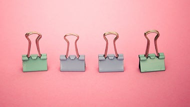 green and grey paperclips on pink background behind developing your career text