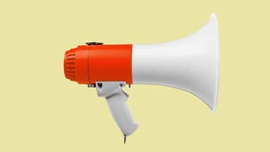megaphone on yellow background behind interview advice text
